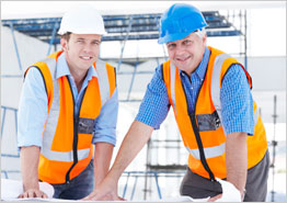 Workers in Hard Hats Standing at Table